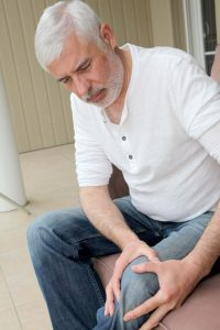 Senior man with osteoarthritis pain